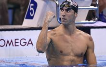 Michael Phelps celebrates after winning the Men's 200m Butterfly Final during the swimming event at the Rio 2016 Olympic Games.