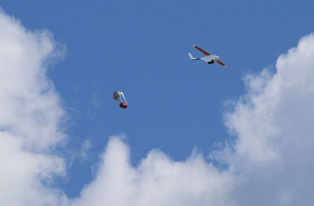 A Zipline drone dropping off medical supplies