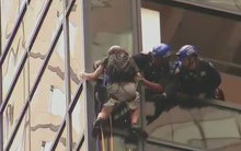 A man climbs Trump Tower using what appeared to be suction cups.