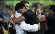 New Zealand's captain Scott Curry (left) gets a hug from team mate Akira Ioane after their quarter final loss to Fiji in the Men's rugby sevens at the Rio Olympics.