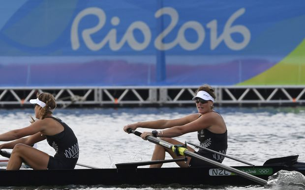 New Zealand's Genevieve Behrent and New Zealand's Rebecca Scown (L) row during the Women's Pair semifinal rowing competition at the Lagoa stadium during the Rio 2016 Olympic Games in Rio de Janeiro on August 11, 2016.