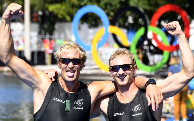 New Zealand's Hamish Bond (R) and New Zealand's Eric Murray celebrate at the end of the Men's Pair final rowing competition at the Lagoa stadium during the Rio 2016 Olympic Games in Rio de Janeiro on August 9, 2016.