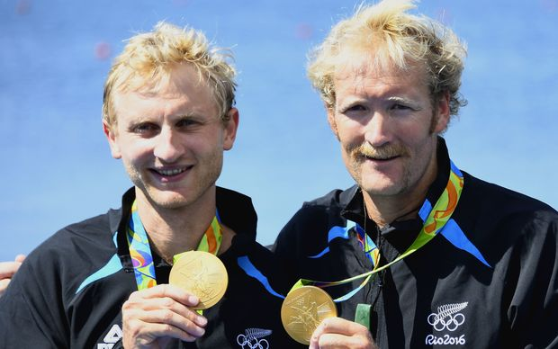 New Zealand's Eric Murray (R) and New Zealand's Hamish Bond (R) celebrate with their gold medals on the podium of Men's Pair final rowing competition at the Lagoa stadium during the Rio 2016 Olympic Games in Rio de Janeiro on August 9, 2016.