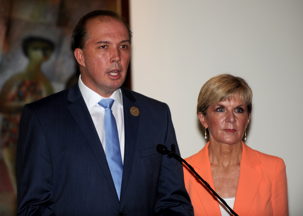Australian Immigration Minister Peter Dutton (L) and Australian Foreign Minister Julie Bishop address journalists during a press conference in Nusa Dua, Bali on March 23, 2016.