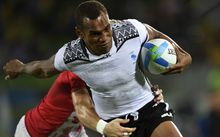 Fiji's Osea Kolinisau scores a try in the men's rugby sevens gold medal match.
