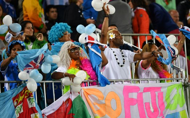 Fiji fans celebrate their teams gold medal win for the men's sevens at Rio olympics.