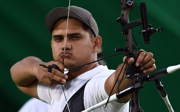Tonga's Arne Hans Jensen shoots an arrow during the Olympic archery competition in Rio.