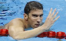 Michael Phelps celebrates winning his 22nd Olympic Games gold medal, and his fourth gold at Rio after winning the 200m medley.