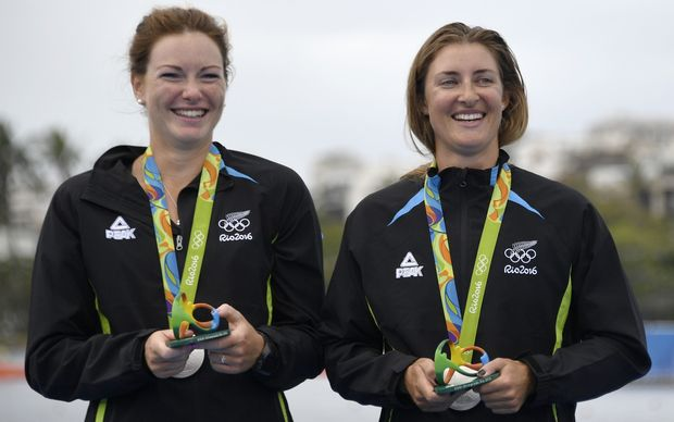 Rebecca Scown and Genevieve Behrent with their medals on the podium of the Women's Pair rowing final at Lagoa stadium in Rio.