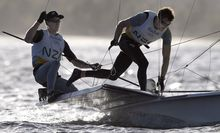 New Zealand's Peter Burling and New Zealand's Blair Tuke compete in the 49er Men sailing class on Guanabara Bay in Rio de Janerio during the Rio 2016 Olympic Games on August 12, 2016.