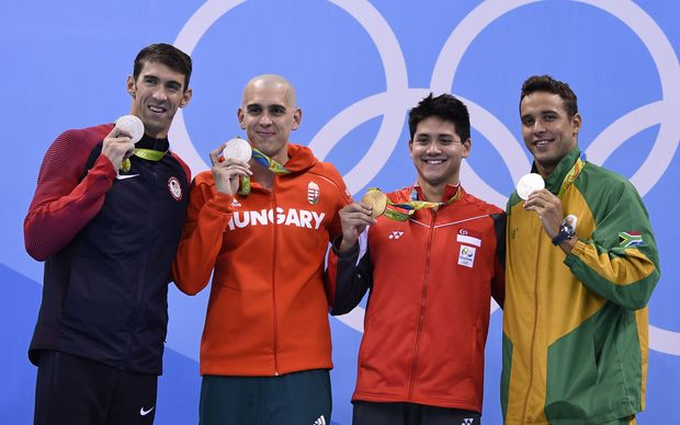 Singapore's Schooling Joseph (2nd on the Right) poses with silver medallists (from Left) USA's Michael Phelps, Hungary's Laszlo Cseh and South Africa's Chad Guy Bertrand Le Clos.