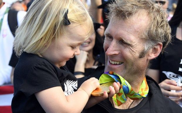 Mahe Drysdale and his daughter Bronte admire his gold medal after winning the men's single sculls.