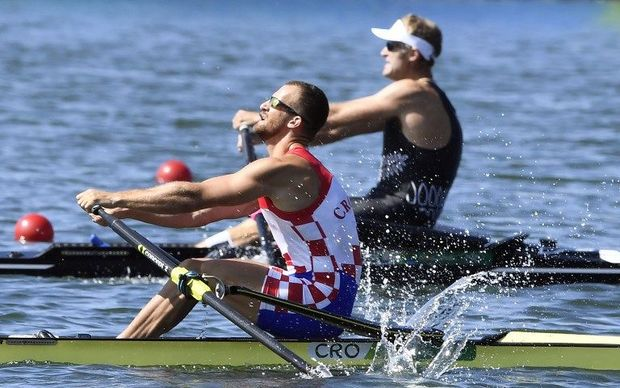 Mahe Drysdale edges ahead of Croatia's Damir Martin in the men's sculls final.