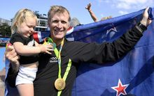 Mahe Drysdale and his daughter Bronte after his Olympic win.