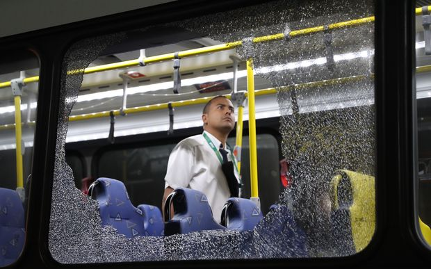 Damage to an Olympic media bus hit while driving on the transolympica highway.