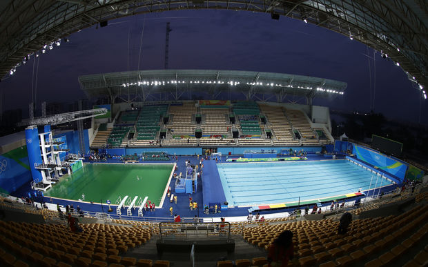 The diving pool at Maria Lenk Aquatics Stadium is a murky green before the Women's Synchronised 10m Platform Final at the Rio 2016 Olympic Games