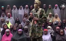 About 50 girls were shown with a gunman who demands the release of Boko Haram fighters.