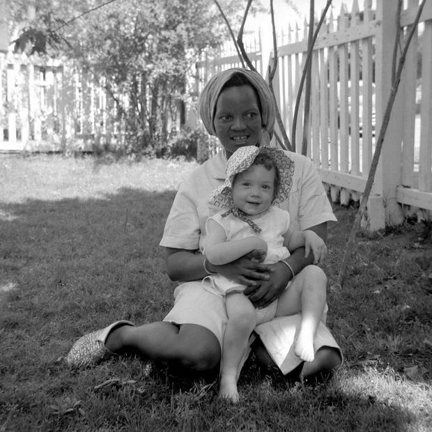 Margaret, Marshal Walker's maid in South Africa, holding one of Marshall's daughters.