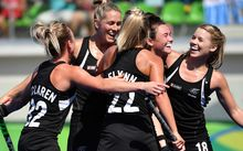 New Zealand's Kelsey Smith (2nd R) clebrates her goal with teammates during the the women's quarterfinal field hockey New Zealand vs Australia match of the Rio 2016 Olympics Games at the Olympic Hockey Centre in Rio de Janeiro on August 15, 2016.