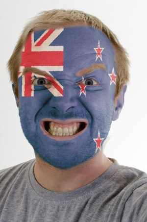 NZ sports supporter with face painted like NZ flag.