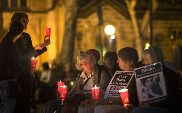 Participants hold a candle light vigil in May 2016 for asylum seekers who set themselves on fire on Nauru.