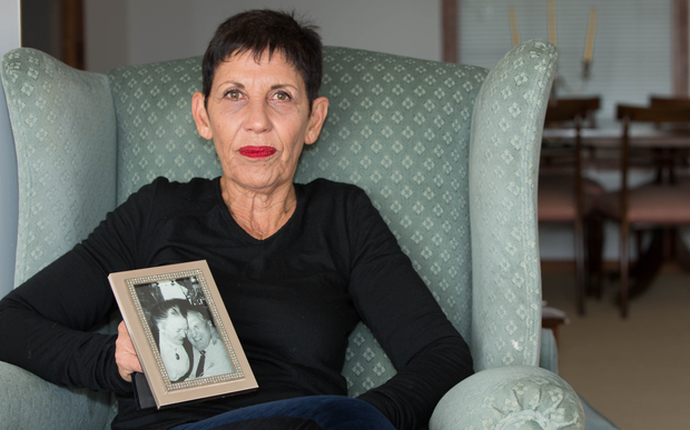 Janet Colby with a photo of her parents.
