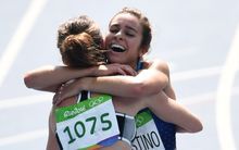 Nikki Hamblin, left, and Abbey D'Agostino after the 5000m Round 1 race.