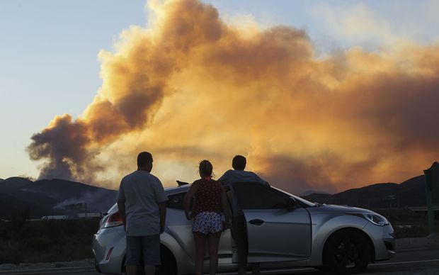 People watch the Blue Cut wildfire in Lytle Creek, California.