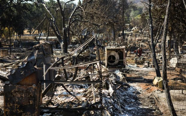 Burned residences are seen in a fire-ravaged neighborhood after the Clayton Fire burned through Lower Lake, California