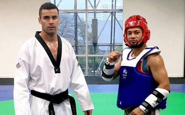 Tonga's Pita Taufatofua and coach Master Paula Sitapa training in Rio.
