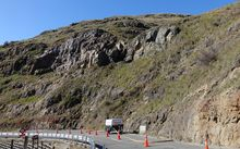 The rock face behind Evans Pass Road needs stabilising.