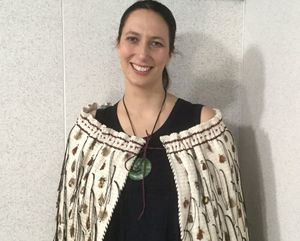 "Jacinta Ruru, wearing ""Rauaroha"", the korowai that is presented every year to the winner of the Supreme Award at the Ako Aotearoa National Tertiary Teaching Excellence Awards."