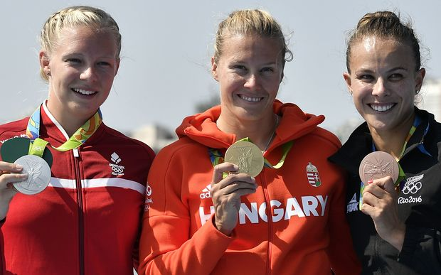 (L-R) Denmark's Emma Jorgensen, Hungary's Danuta Kozak and New Zealand's Lisa Carrington celebrate on the podium after the Women's Kayak Single (K1) 500m event at the Lagoa Stadium during the Rio 2016 Olympic Games in Rio de Janeiro on August 17, 2016.