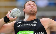 New Zealand's Tomas Walsh competes in the Men's Shot Put Qualifying Round during the athletics event at the Rio 2016 Olympic Games at the Olympic Stadium in Rio de Janeiro on August 18, 2016.