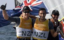New Zealand sailors Peter Burling and Blair Tuke celebrate winning gold at the Rio Olympics.