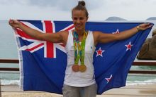 Lisa Carrington with her gold and bronze medals at the Rio Olympics.