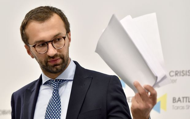 Ukrainian journalist and member of parliament Serhiy Leshchenko holds pages showing alleged signings of payments to Trump presidential campaign chairman Paul Manafort from an illegal shadow accounting book of former Ukrainian president Viktor Yanukovych's party