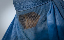 A woman in a burqa in the old city of Kabul.