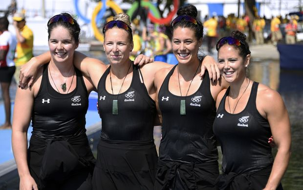 Aimee Fisher, Caitlin Ryan, Kayla Imrie and Jaimee Lovett celebrate after the Women's Kayak Four (K4) 500m semi-final at the Rio 2016 Olympic Games.