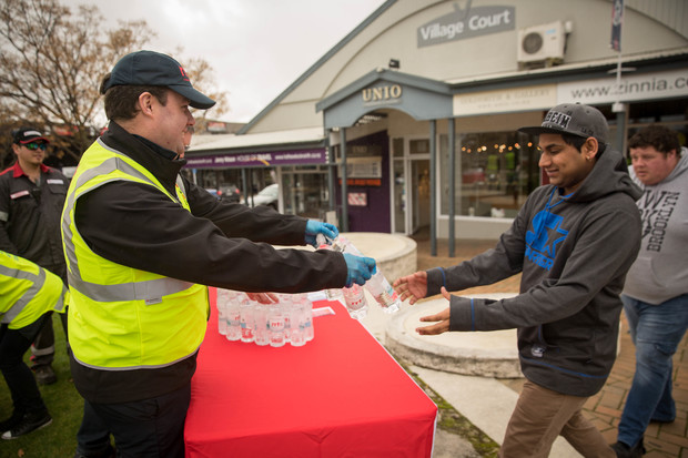 Red Cross volunteers handing out water in Havelock North. 20 August 2016.