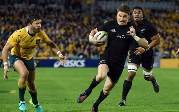 Beauden Barrett runs for a successful try as Australia's Adam Ashley-Cooper looks on.