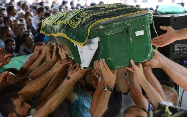 People carry a coffin during a funeral for victims of the attack.