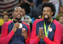 Kevin Durant and DeAndre Jordan from USA basketball team show off their gold medals at Rio Olympics