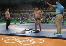 Mongolian wrestling coaches strip ff in protest of 65kg bronze medal match outcome