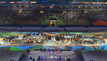 Dancers form the shape of the Olympics rings logo at the Rio 2016 closing ceremony.