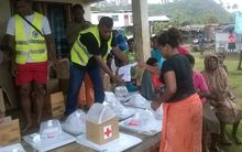 The Fiji Red Cross distributing relief items in Nakodu Village, Koro Island.