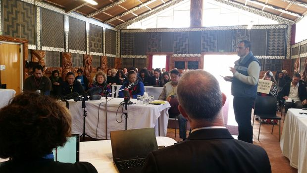 Hurimoana Dennis speaking to panel of MPs at Te Puea Marae