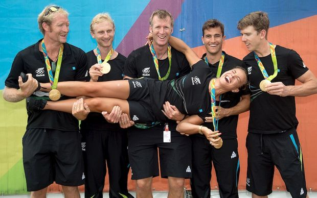 New Zealand Olympic gold medal winners Eric Murray, Hamish Bond, Mahe Drysdale, Peter Burling, Blair Tuke and Lisa Carrington, outside the Athletes village at the 2016 Rio Olympics.