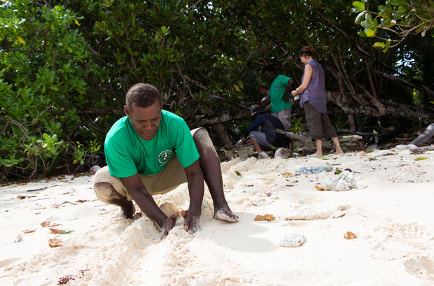 ACMCA conservation officer Dickson Motui builds a pathway for the hawksbill turtle hatchlings.