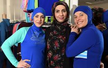 Muslim models display burkini swimsuits at a shop in western Sydney